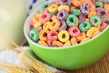 Colorful cereal loops with different fruit flavour in green bowl with milk in the back (Selective Focus, Focus one third into the bowl) Stock Photo - 9996992