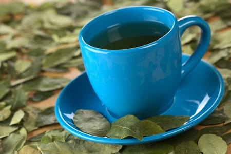 Popular Peruvian herbal tea made of dried coca (lat. Erythroxylum coca) leaves (Selective Focus, Focus on the front rim of the cup and the front of the second from left coca leaf on the saucer) Stock Photo - 10201840
