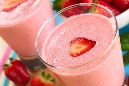 Fresh strawberry milkshake (Selective Focus, Focus on the front edge of the strawberry slice on the milkshake)