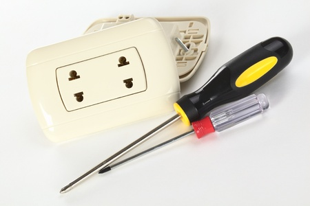 Two Peruvian plastic sockets with philipshead screwdrivers on white (Selective Focus, Focus on the socket)  photo