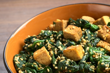Tofu, spinach and sesame stir-fry fried with garlic and ginger (Selective Focus, Focus on the front of the tofu in the front)