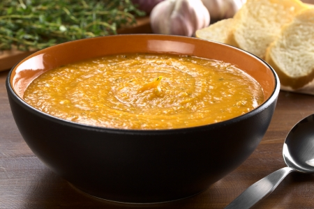 potato soup: Cream of sweet potato prepared with garlic, thyme and basil (Selective Focus, Focus on the middle of the soup)