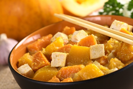 Tofu, pumpkin and sweet potato curry (Selective Focus, Focus one third into the dish on the two tofu pieces and the pumpkin piece inbetween) photo