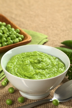 green pea: Fresh green pea soup on jute with copy space  Stock Photo