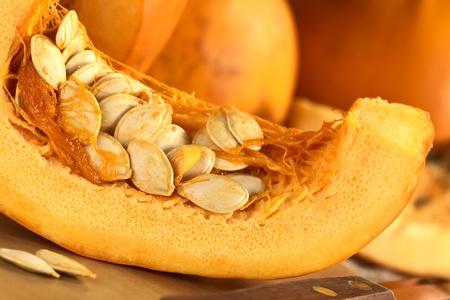 pumpkin seeds: Fresh pumpkin slice with pumpkin seeds