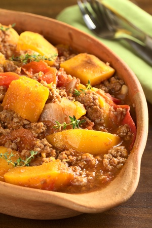 mincemeat: Pumpkin, tomato, mincemeat dish with fresh thyme Stock Photo