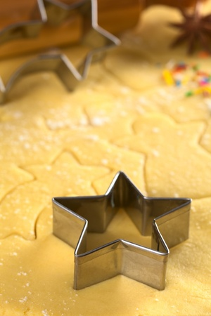 Star-shaped cookie cutter and other Christmas shapes cut into dough Stock Photo - 11150445