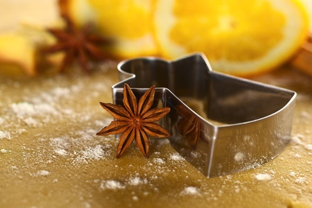 baking ingredients: Star anise with angel shaped cookie cutter on dough (Selective Focus, Focus on  the anise)