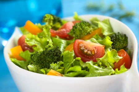 Fresh vegetable salad made of cherry tomato, broccoli, yellow bell pepper and lettuce  photo