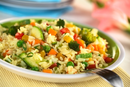 zucchini: Vegetable risotto made of zucchini, pea, carrot, red bell pepper, broccoli and pumpkin (Selective Focus, Focus one third into the risotto)