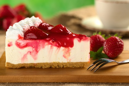 Fresh strawberry cheesecake (Selective Focus, Focus on the front upper edge of the cake) photo