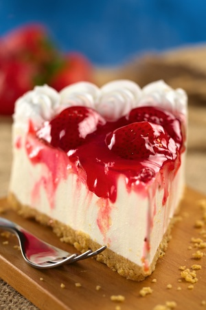 Fresh strawberry cheesecake (Selective Focus, Focus on the glazing running down on the left and the front of the first strawberry on the cake) Stock Photo - 11736067