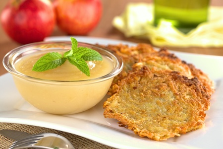 fritter: Apple sauce with potato fritters  Stock Photo