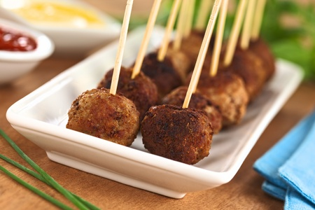 Meatball appetizers with toothpicks and sauces on the side Stock Photo - 12325360