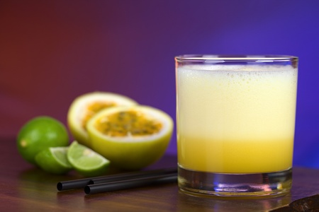 Maracuya Sour, a popular Peruvian cocktail made of maracuya and lime juice, pisco, syrup and egg white  Stock Photo