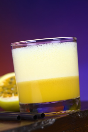 Maracuya Sour, a popular Peruvian cocktail made of maracuya and lime juice, pisco, syrup and egg white ( photo