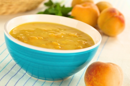 cold soup: Refreshing cold peach soup in blue bowl (Selective Focus, Focus one third into the soup) Stock Photo