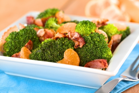 Fresh homemade broccoli, mandarin and bacon salad in white bowl (Selective Focus, Focus on the broccoli and the mandarin in the front) Stock Photo - 13699588