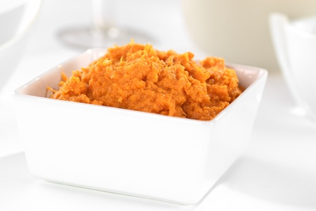 Sweet potato spread in white bowl Stock Photo