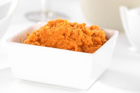 prepared potato: Sweet potato spread in white bowl Stock Photo