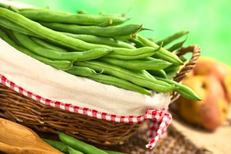 french bean: Fresh raw green beans in basket (Selective Focus, Focus on the beans in the front in the basket)