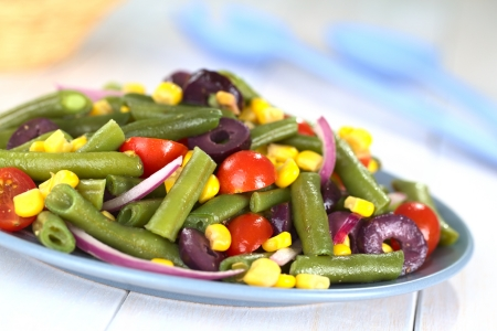 bush bean: Fresh vegetarian green bean salad with cherry tomatoes, corn, black olives and onion (Selective Focus, Focus one third into the salad)