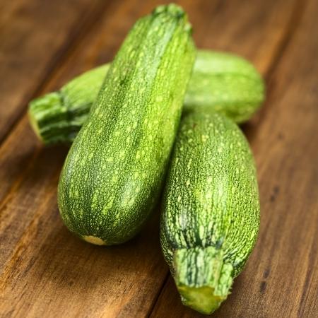cucurbita: Raw zucchini on dark wood