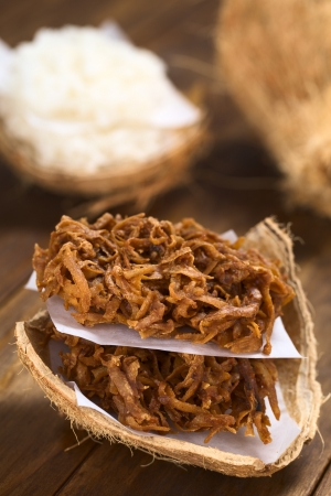 colombian food: Peruvian cocadas, a traditional coconut dessert sold usually on the streets, made of grated coconut and white or brown sugar, which gives the different coloring of the sweet (Selective Focus, Focus on the front of the cocadas) Stock Photo