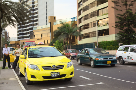 miraflores: LIMA, PERU - MARCH 16, 2012  Unidentified taxi drivers standing next to yellow cabs on the Malecon de la Reserva at Larcomar waiting for passengers on March 16, 2012 in Miraflores, Lima, Peru  There are many taxis in Lima, and they are used very frequentl