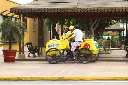 LIMA, PERU - APRIL 19, 2012: Unidentified mobile ice cream vendors with DOnofrio ice cream carts standing close to the Municipality building along Pedro de Osma Avenue in the district of Barranco on April 19, 2012 in Lima, Peru.