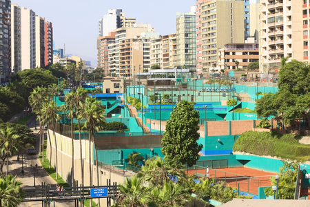 miraflores district: LIMA, PERU - FEBRUARY 20, 2012: The tennis club Club Tennis Las Terrazas situated between the streets Bajada Balta and Malecon 28 de Julio in the district of Miraflores on February 20, 2012 in Lima, Peru. Miraflores is one of the most modern and richest Editorial
