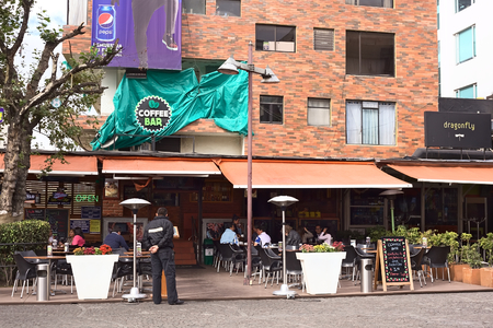 QUITO, ECUADOR - AUGUST 6, 2014: Outdoor sitting area of the Coffee Bar restaurant on Plaza Foch in the tourist district La Mariscal on August 6, 2014 in Quito, Ecuador. Plaza Foch is situated at the intersection of the streets Reina Victoria and Mariscal