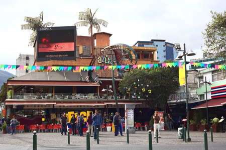 QUITO, ECUADOR - AUGUST 6, 2014: Unidentified people standing on Plaza Foch in front of the Azuca Latin Bistro and Chelsea restaurant-bar-lounge in the tourist district La Mariscal on August 6, 2014 in Quito, Ecuador. Plaza Foch is situated at the interse