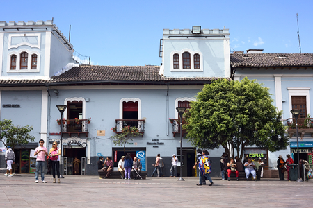 QUITO, ECUADOR - AUGUST 4, 2014: Unidentified people on Plaza del Teatro opposite the Sucre National Theater in the historic city center on August 4, 2014 in Quito, Ecuador. Quito is an UNESCO World Cultural Heritage Site.