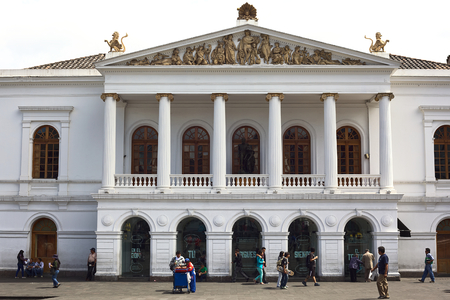 QUITO, ECUADOR - AUGUST 4, 2014: Unidentified people walking in front of the Teatro Nacional Sucre (Sucre National Theater) on Plaza del Teatro in the historic city center on August 4, 2014 in Quito, Ecuador. Quito is an UNESCO World Cultural Heritage Sit
