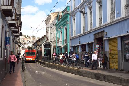 QUITO, ECUADOR - AUGUST 4, 2014: Unidentified people on Juan Jose Flores street in the city center at the trolley bus stop Plaza del Teatro on August 4, 2014 in Quito, Ecuador. Quito is an UNESCO World Cultural Heritage Site.