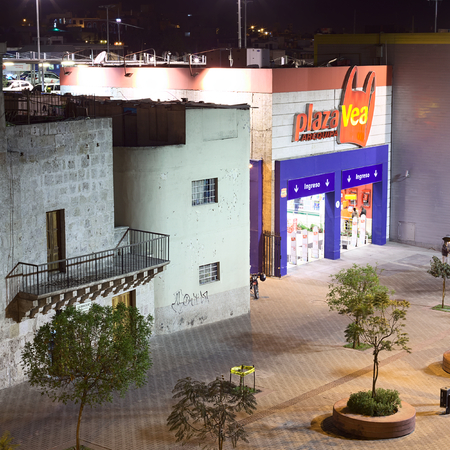 interbank: AREQUIPA, PERU - AUGUST 14, 2014: Entrance of Plaza Vea supermarket on La Marina street in the evening on August 14, 2014 in Arequipa, Peru. Plaza Vea is the largest supermarket chain in Peru and is part of Supermercados Peruanos S.A. Editorial
