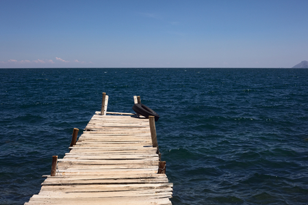 space weather tire: Wooden jetty leading into Lake Titicaca close to the small tourist town of Copacabana in Bolivia