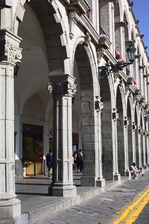 unesco world cultural heritage: AREQUIPA, PERU - AUGUST 22, 2014: The archway of Paseo Portal de Flores on Plaza de Armas (main square) on August 22, 2014 in Arequipa, Peru. The city center of Arequipa is UNESCO World Cultural Heritage Site.