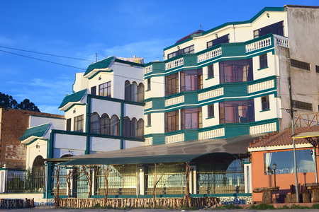 COPACABANA, BOLIVIA - OCTOBER 17, 2014: Hotel Residencial Brisas del Titicaca on the shore of Lake Titicaca on October 17, 2014 in the small tourist town Copacabana, Bolivia. Boats to Isla del Sol (Sun Island) depart from this town.