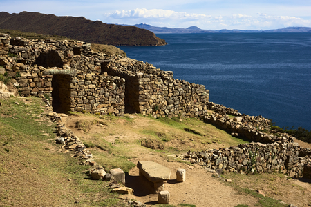 reachable: Chinkana (meaning labyrinth in quechua) archeological site of Tiwanaku (Tiahuanaco) origin on the Northwestern part of the Isla del Sol (Island of the Sun) in Lake Titicaca in Bolivia. Isla del Sol is a popular tourist destination and is reachable by boat Stock Photo
