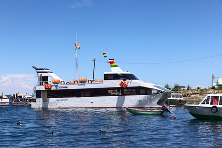 COPACABANA, BOLIVIA - OCTOBER 28, 2014: Big passenger ferry in the harbor of the small tourist town on the shore of Lake Titicaca on October 28, 2014 in Copacabana, Bolivia
