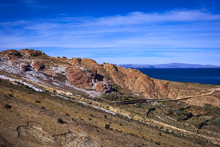 Colorful rocky hillside with path leading to the archeological site on the northern part of the Isla del Sol (Island of the Sun) in Lake Titicaca, which is a popular travel destination in Bolivia photo