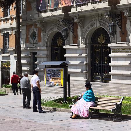 municipal editorial: LA PAZ, BOLIVIA - OCTOBER 11, 2014: Unidentified people in front of the entrance of the Palacio Consistorial Gobierno Municipal de La Paz (city hall) on Mercado street in the city center on October 11, 2014 in La Paz, Bolivia
