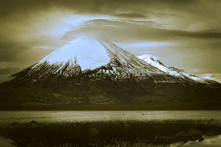 dual: Parinacota stratovolcano (6348 meters) and Chungara Lake on the border of Chile and Bolivia on the way from La Paz to Arica. Parinacota is part of the Payachata volcanic group in Northern Chile. (Dual Toned Image)