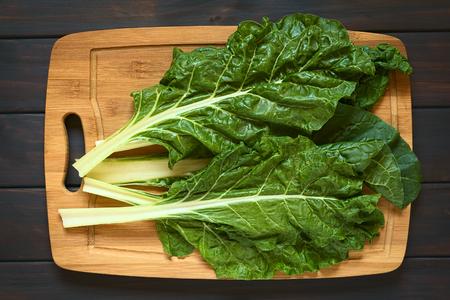 beta: Overhead shot of raw chard leaves (lat. Beta vulgaris) on wooden board