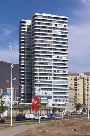 arturo: IQUIQUE, CHILE - JANUARY 23, 2015: The entrance area of the modern residential building complex called Archipielago Mar Egeo along the Arturo Prat Chacon avenue on the Pacific coast on January 23, 2015 in Iquique, Chile