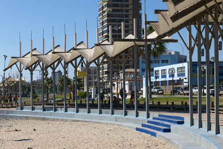 sitting area: IQUIQUE, CHILE - FEBRUARY 10, 2015: Partly shaded sitting area along the Pacific coast on February 10, 2015 in Iquique, Chile. Iquique is a popular beach town and free port city in Northern Chile. Editorial