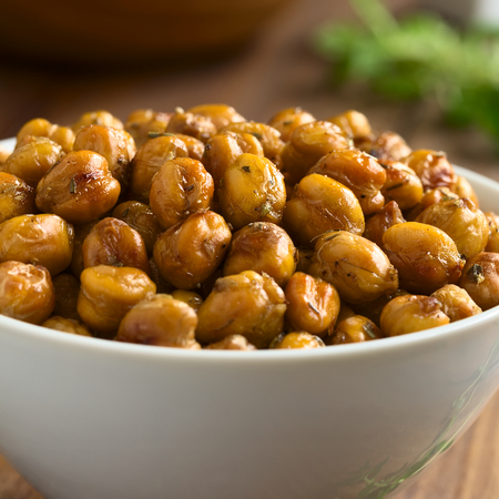 garbanzo bean: Chickpeas roasted with thyme, oregano, salt and pepper, photographed with natural light (Selective Focus, Focus on the chickpeas on the top)