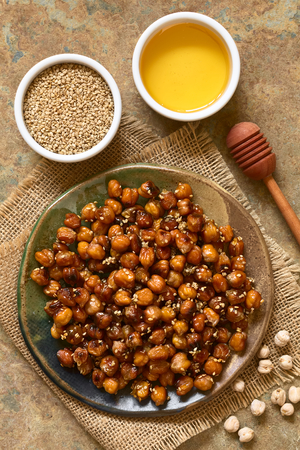 roasted sesame: Chickpeas roasted with sesame and honey, photographed overhead on slate with natural light